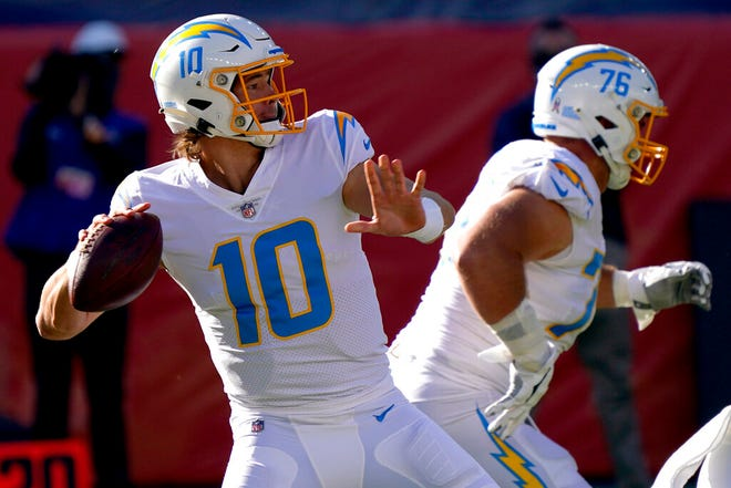 Los Angeles Chargers quarterback Justin Herbert (10) looks to pass during the first half against the Denver Broncos on Sunday. (AP Photo/David Zalubowski)