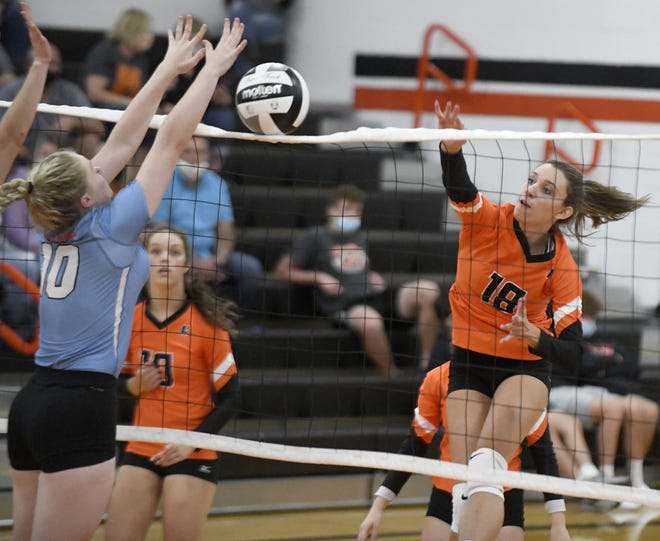 Marlington's Natalie Maiorana scores a point with defense from Alliance's Abbey West at Marlington.(IndeOnline.com / Kevin Whitlock)