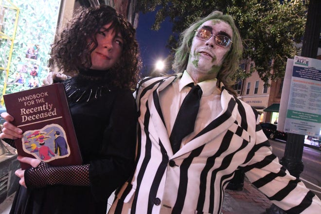 People dressed up for Halloween hit the streets of downtown Wilmington in their best costumes in 2020. [KEN BLEVINS/STARNEWS]