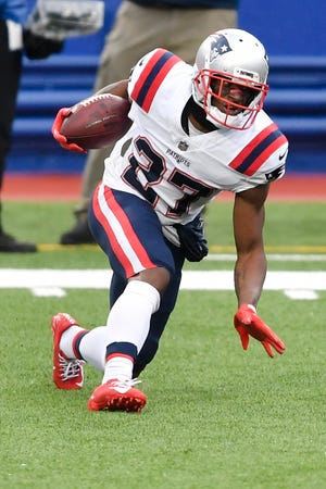 New England defensive back J.C. Jackson runs back an interception during the first half of Sunday's game.