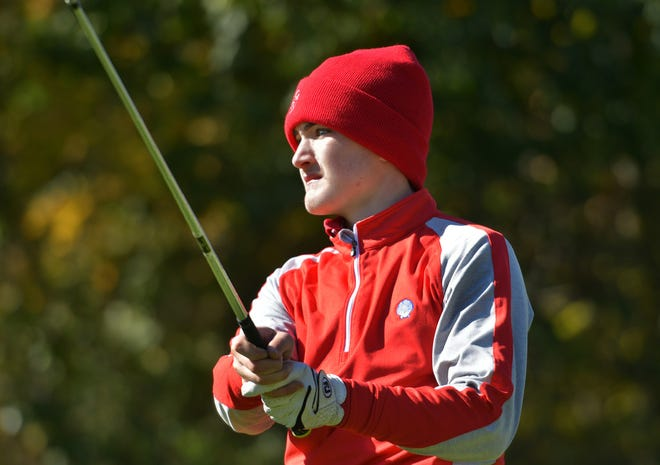 St. John's Ray Dennehy watches his drive during the Central Mass. Division 1 golf championship at Shining Rock GC in 2018.