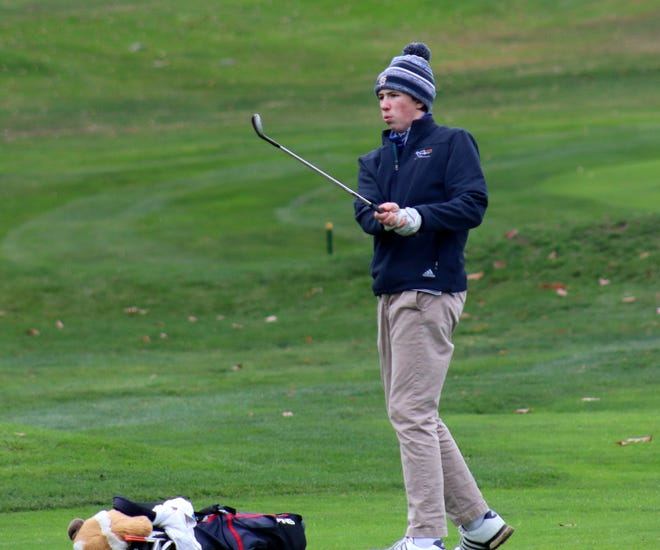 St. Bernard's sophomore Patrick Ginnity chips to the ninth green at Oak Hill Country Club in the Pod 9 Championship.