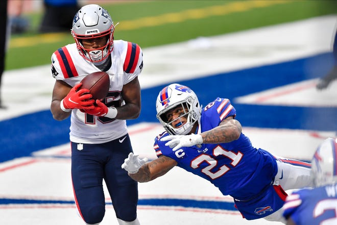 Buffalo free safety Jordan Poyer dives for the ball thrown to New England's Jakobi Meyers for a two point conversion during Sunday's game.