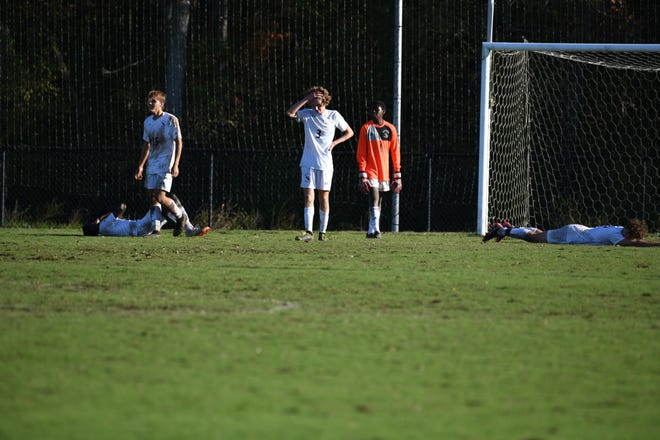 Fayetteville Academy players fall to the pitch after Westchester Country Day's free-kick goal with 9.9 seconds remaining to take a 3-2 lead in the NCISAA 2-A championship game in High Point on Saturday, Oct. 31, 2020.