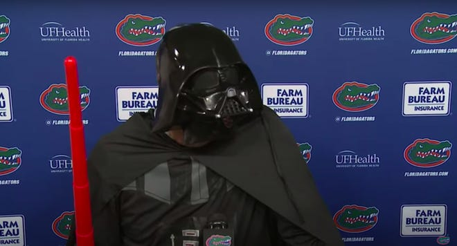 Zoom screen shot of Florida coach Dan Mullen dressed on Halloween night as Darth Vader.