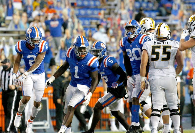Florida defensive players celebrate a fumble recovery by Brenton Cox Jr. (1) during Saturday's game against Missouri at Ben Hill Griffin Stadium.