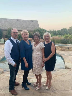 Dover resident Margo Sholtz (second from left) is shown with recently discovered half-siblings (left to right) Keith Collins, Rhonda Novotney and Roxanne Pollard.