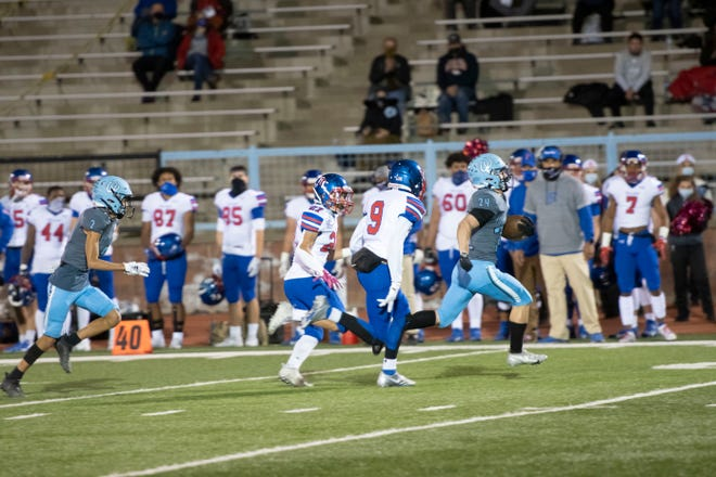 Pueblo West High School junior running back Hunter Johnson (right) out runs two Fountain-Fort Carson on a big run play to open the game during the Cyclones' 35-21 loss Friday at Cyclones Stadium.