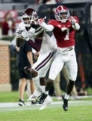 Oct 31, 2020; Tuscaloosa, Alabama, USA;  Alabama defensive back Brandon Turnage (7) breaks up a pass intended for Mississippi State wide receiver Malik Heath (4) at Bryant-Denny Stadium during the second half of Alabama's 41-0 win over Mississippi State. Mandatory Credit: Gary Cosby Jr/The Tuscaloosa News via USA TODAY Sports
