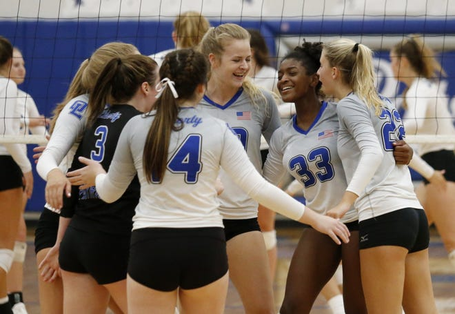 Olentangy Liberty's Abby Roubinek (24), Madison Tinsley (3), McKenna Cook (14), Nicole Russell (20), Gabi Moulton (33) and Logan Flaugh (22) celebrate a point against Hilliard Bradley on Sept. 17. The Patriots won a Division I district title Oct. 31.