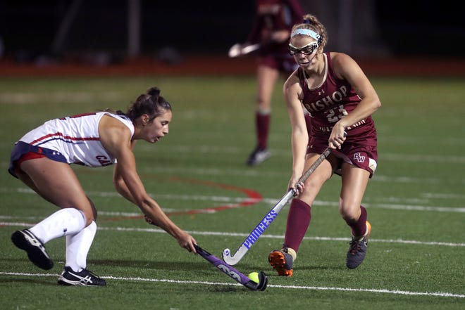 Watterson's Zoe Coleman, right, and Thomas Worthington's Cora Hamilton battle for possession during a game Oct. 5. The Eagles defeated the Cardinals 2-1 on Oct. 31 in a district final.