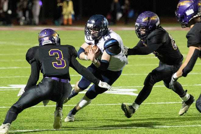 Adena senior Nate Throckmorton avoids a tackle as he attempts to score against Mechanicsburg in a Division VI regional semifinals game on Oct. 31, 2020, in London, Ohio. Adena lost 42-14.