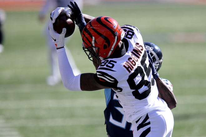 Cincinnati Bengals wide receiver Tee Higgins (85) catches a pass along the sideline during the first quarter of a Week 8 NFL football game against the Tennessee Titans, Sunday, Nov. 1, 2020, at Paul Brown Stadium in Cincinnati.