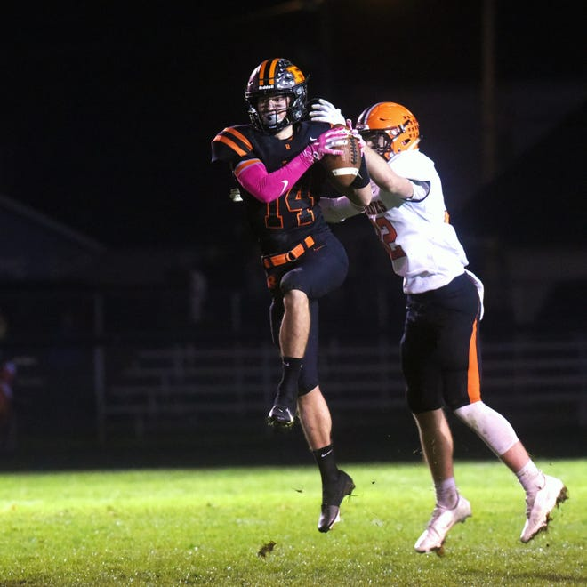 Dalton Patterson intercepts a pass on fourth down in the final minute of the fourth quarter to secure Ridgewood's 13-10 win against Wheelersburg on Saturday night in a Division V, Region 19 semifinal in West Lafayette.
