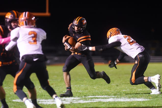Deontae Brandon runs with the ball during Ridgewood's 13-10 win against Wheelersburg in a Division V, Region 19 semifinal on Saturday in West Lafayette.