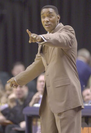 Pacers head coach Isiah Thomas tries to get his team moving as they trailed the New Jersey Nets. April 26, 2002