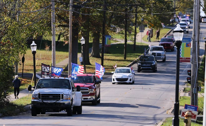 A caravan of Trump Train supporters of President Donald Trump left the Eastern High School as they headed to a rally at the Kentucky Fair and Exposition Center in Louisville, Ky. on Nov. 1, 2020.