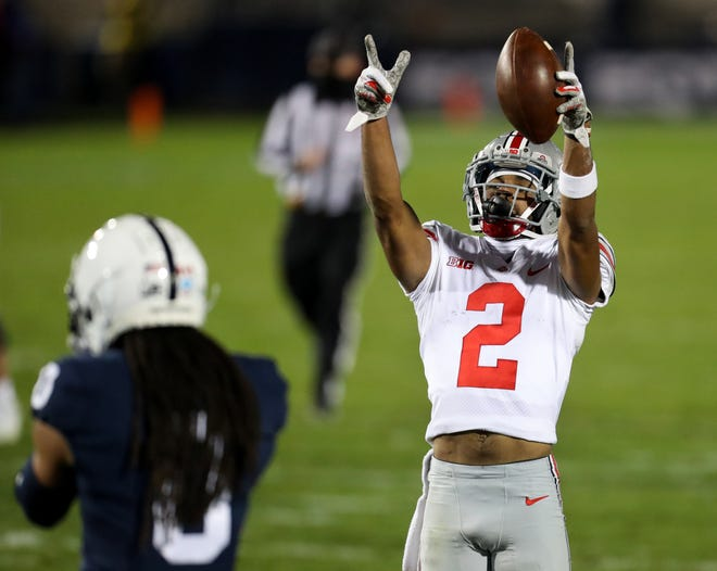 Ohio State receiver Chris Olave gestures after picking up a first down in Saturday's win at Penn State