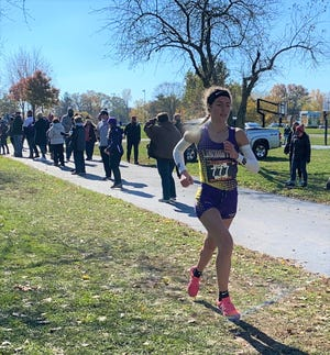 Halle Hamilton won an individual title by 15 seconds in leading Lexington to its seventh straight regional cross championship