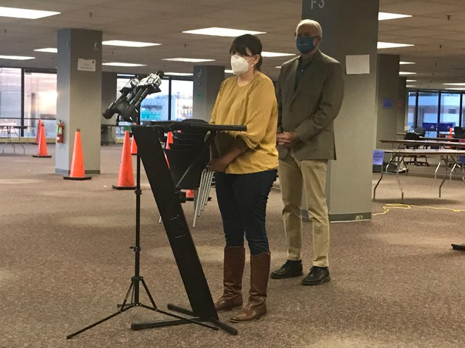 Election Commission Executive Director Claire Woodall-Vogg and Milwaukee Mayor Tom Barrett speak to reporters Sunday from the place where all City of Milwaukee absentee ballots will be counted on Tuesday.