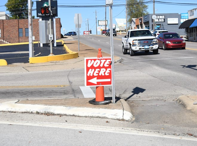 A sign points the way towards the First United Methodist Church in Mountain Home, one of three early voting sites in Baxter County. Early voting will close Monday evening.