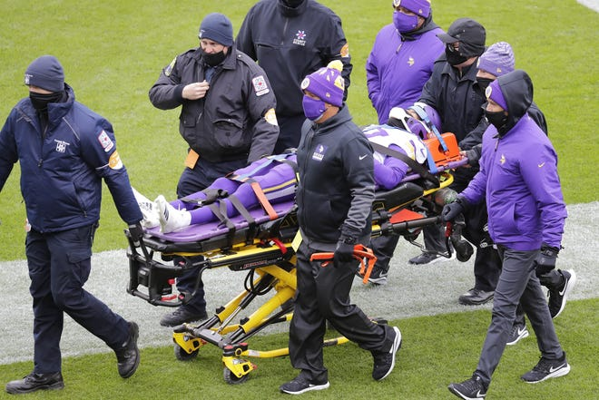 Minnesota Vikings cornerback Cameron Dantzler (27) is carted off the field after getting injured against the Green Bay Packers during their football game Sunday, November 1, 2020, at Lambeau Field in Green Bay, Wis.