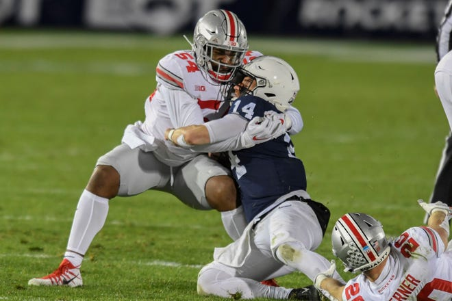 Ohio State defensive end Tyler Friday (54) tackles Penn State quarterback Sean Clifford (14) during the second quarter of an NCAA college football game in State College, Pa., Saturday, Oct. 31, 2020. (AP Photo/Barry Reeger)