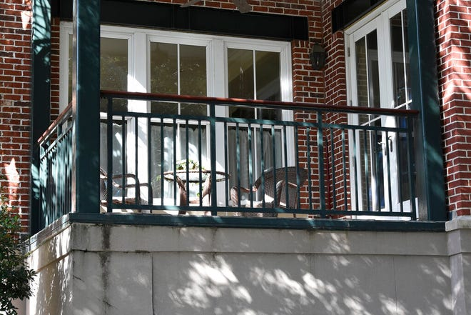 """This photo shows the outside of a Charleston, S.C., condominium belonging to Eugene Zurlo on Monday, Oct. 19, 2020. The Trump administration recently gave the longtime Republican political donor seed money to test a possible COVID-19-fighting blood plasma technology, noting Zurlo's """"manufacturing facilities"""" in Charleston. An AP investigation found no manufacturing facilities. The company operates out of Zurlo's condo. He and his partners may now be in line for as much as $65 million in taxpayer money. (AP Photo/Meg Kinnard)"""