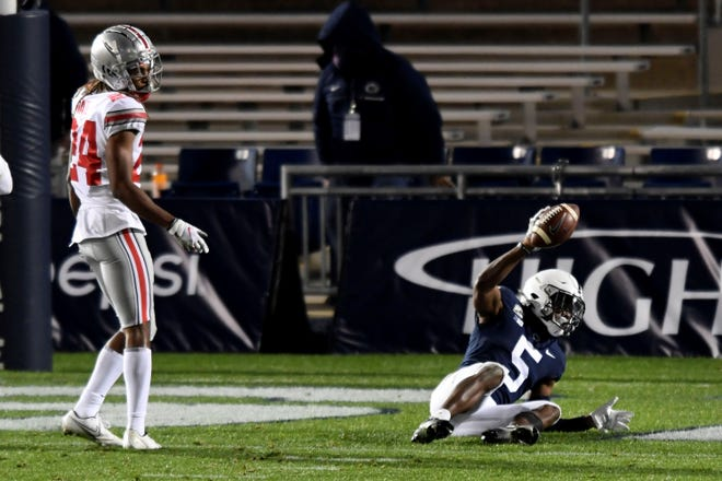 Penn State wide receiver Jahan Dotson (5) celebrates his fourth-quarter touchdown reception Ohio State cornerback Shaun Wade (24) watches during an NCAA college football game in State College, Pa., Saturday, Oct. 31, 2020. Ohio State won 38-25. (AP Photo/Barry Reeger)