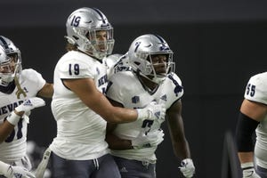 Nevada pass-catchers Cole Turner, left, and Romeo Doubs were both named to the All-Mountain West football team Thursday.