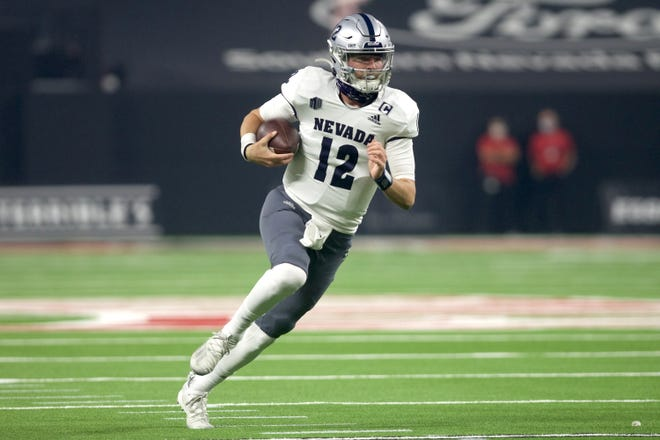 Nevada's Carson Strong looks for running room Saturday night st UNLV.