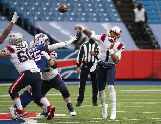 Bills defensive end Jerry Hughes pressures Patriots quarterback Cam Newton.