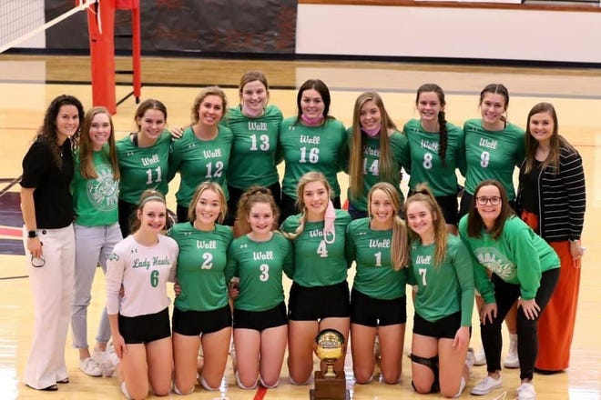 The Wall High School volleyball team beat Odessa Compass in a Class 3A bidistrict volleyball match Saturday, Oct. 31, 2020, in Colorado City. It was the 200th career victory for head coach Robynn Jones (far left, standing).
