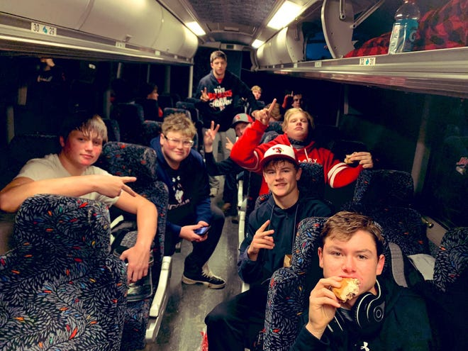 St. Mary football team members prepare for the six-hour bus ride back to Dell Rapids after their quarterfinal win over Faith.