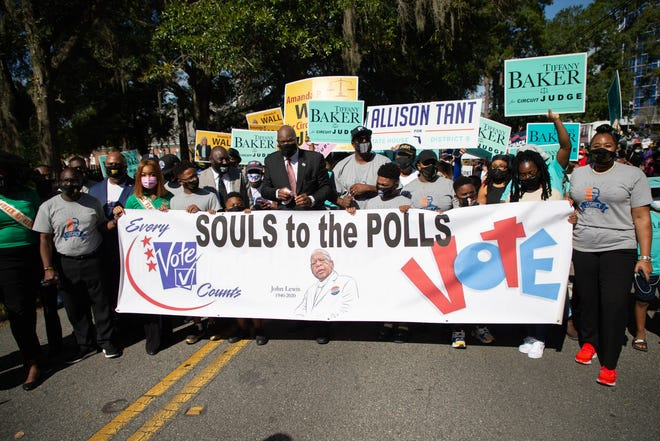Lead by Rev. R.B. Holmes and family members of George Floyd, hundreds marched from Bethel Missionary Baptist Church to the Donald L. Tucker Civic Center for the Souls to the Polls event Sunday, Nov. 1, 2020.