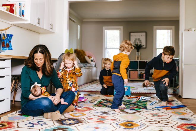 Melissa Wirt, the owner of Latched Mama, an online clothing retailer geared to nursing moms based in Midlothian, Virginia, with her five kids