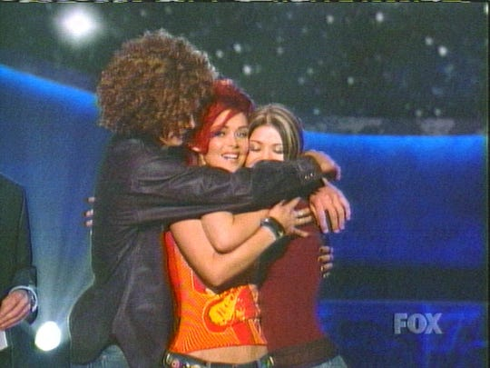 Justin Guarini, Nikki McKibbin and Kelly Clarkson hug after McKibbin was voted off the show in 2002.