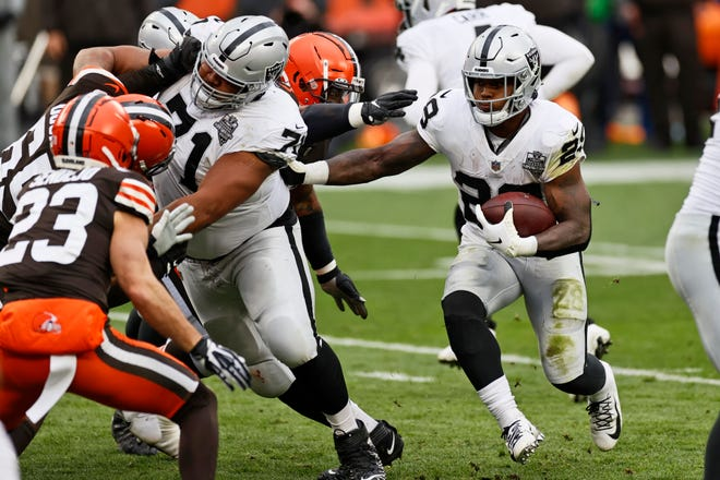 Las Vegas Raiders running back Josh Jacobs (28) rushes during the first half of an NFL football game against the Cleveland Browns, Sunday, Nov. 1, 2020, in Cleveland.
