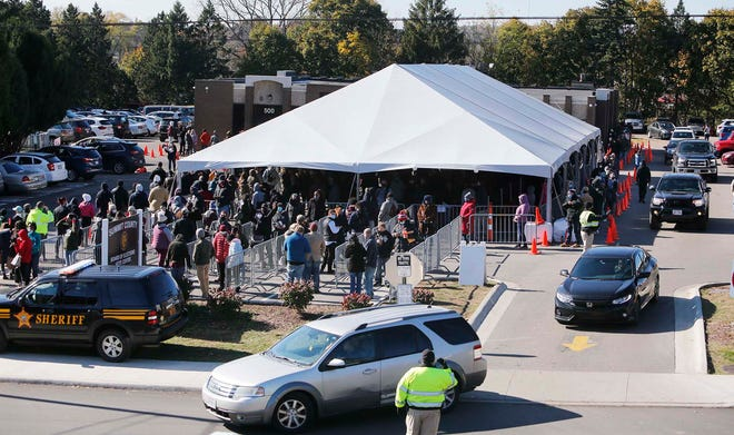 The Ohio Secretary of State's office wants the Summit County Board of Elections to develop a better plan for accommodating heavy turnout for early voting. This Nov. 1 photo shows a line of early voters wrapped around board office and into the tent during the final day of early voting. Wait times were up to three hours.