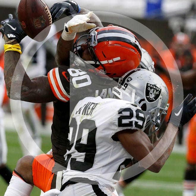 Las Vegas Raiders safety Lamarcus Joyner (29) hits Cleveland Browns wide receiver Jarvis Landry (80) breaking up a pas during the fourth quarter an NFL football game, Sunday, Nov. 1, 2020, in Cleveland. (AP Photo/Kirk Irwin)