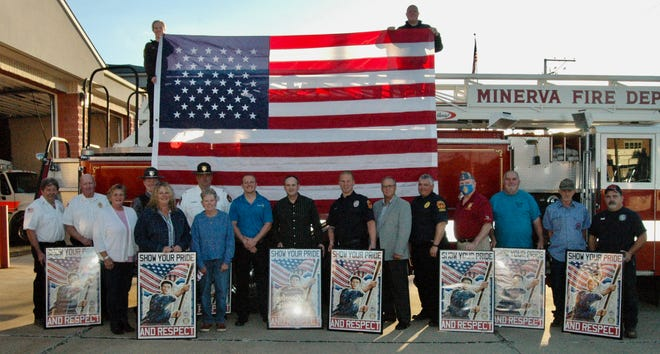 Front: Connie Dowling, Marie Popick, and Rose Hopp Back: Jim Moore, Fred Barnett, Haden Stiner, Chris Miller, Chris Debo, Kirt Henman, Jake Walter, Tim Tarbet, Aaron Stoller, Bill Towns, Terry Gruber, Ron Dinger, and Paul Hilderbrand Standing on the fire truck: Tarent Mitchell and Brent Bratu
