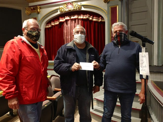 Jim Danner, trustee, and Don Riffle, first vice commander of Loudon Post 257 of the American Legion, present a check for $15,283.10 to Mayor Steve Stricken at the Oct. 19 Loudonville Council meeting. The funds are to help with payoff of the new village maintenance building.
