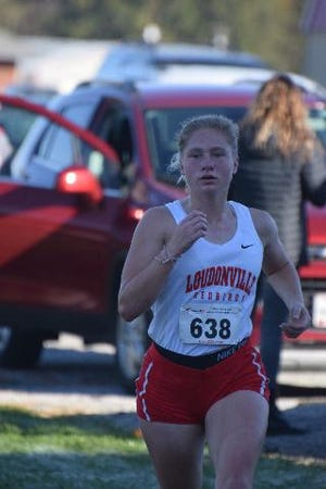 Catlyn Kauffman running earlier this fall in the Mid-Buckeye Conference Cross Country meet, which she won.