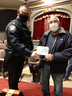 Capt. Brian McCauley accepts a check from Don Riffle of Loudon Post 257 of the American Legion for $5,000 for the new Loudonville Police Department Canine Unit. Presentation was made at the Oct. 19 council meeting.