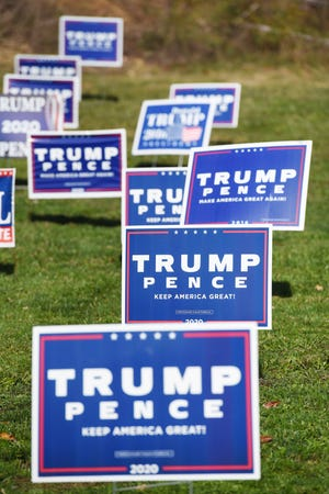 Trump-Pence election signs dominate a yard along Route 18 in Raccoon Township on Monday morning.