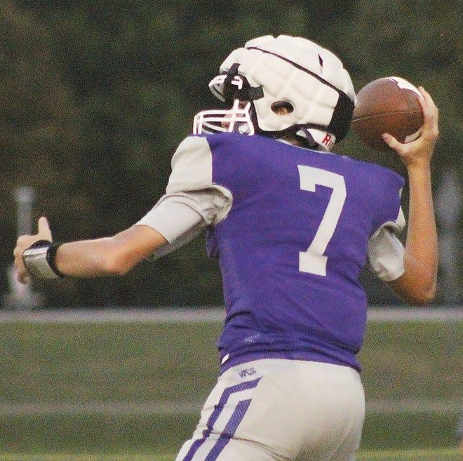 Freshman quarterback Tyrel Cloud prepares to fire a pass for Wesleyan Christian School.
