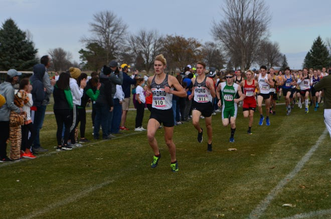 Clay Pehl And Jason Renze lead the pack at the 2020 state cross country meet in Fort Dodge.