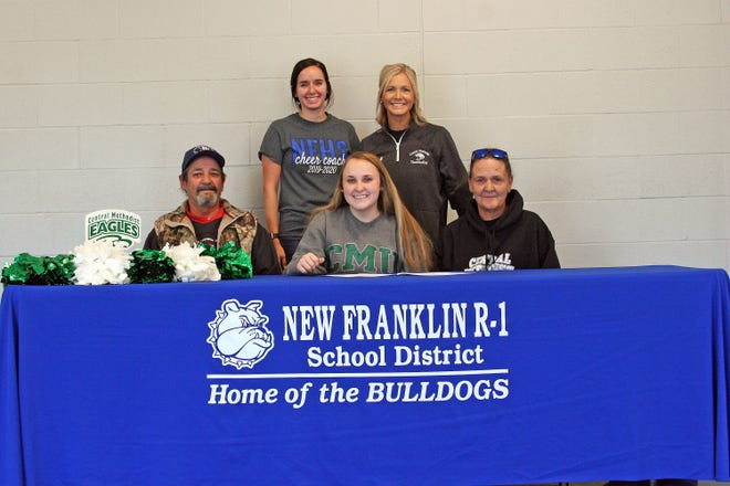 Keota Boren, center front, signed a letter-of-intent Friday with Central Methodist University as a cheerleader. She is joined by Dale Boren, Sandy Boren, New Franklin coach Kelsey Dobson and CMU coach Terin Fuemmeler.
