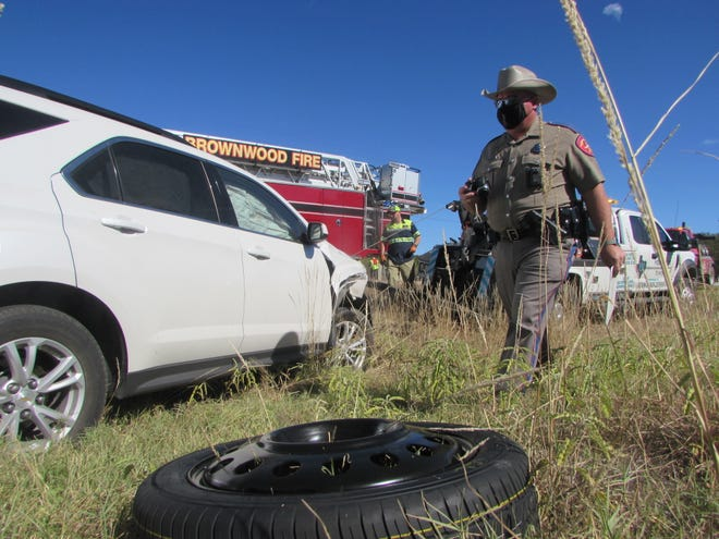 Texas Department of Public Safety trooper John Moody walks near an SUV that was involved in two-vehicle collision, caused by a wrong-way driver Monday morning on U.S. Highway 67/84 between Brownwood and Bangs. The drivers of the SUV and a vehicle traveling ahead of it collided with each other after managing to avoid the wrong-way vehicle. A woman and child in the SUV were transported by Lifeguard Ambulance, Moody said. The SUV rolled over after the collision and was uprighted by Welch Brothers Towing. The wrong-way driver did not stop and was not located by law enforcement.