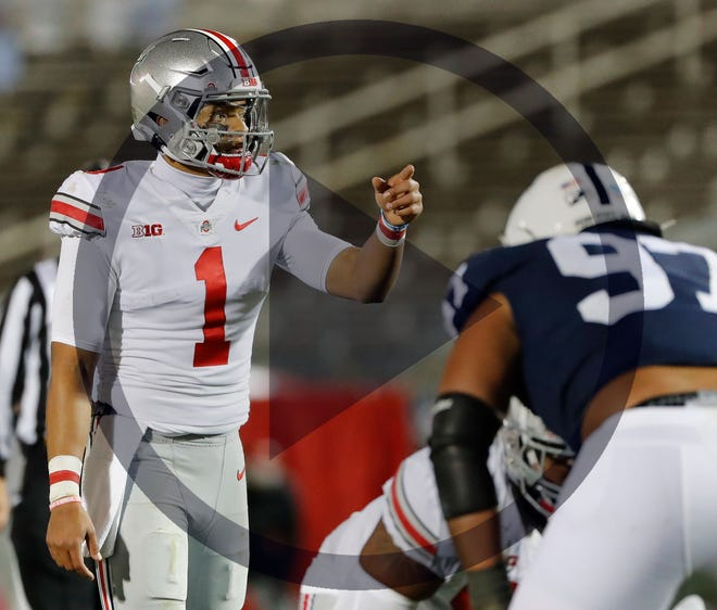 In this file photo, Ohio State Buckeyes quarterback Justin Fields (1) calls a play at the line of scrimmage during the third quarter of the NCAA football game at Beaver Stadium in University Park, Pa. on Sunday, Nov. 1, 2020.